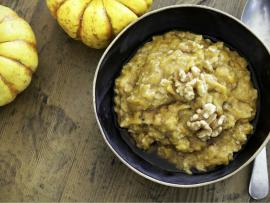 bowl of steaming hot pumpkin spice oatmeal