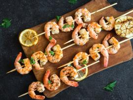 Curry roasted shrimp on skewers with garlic and cilantro