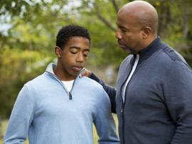 african american son and dad talking