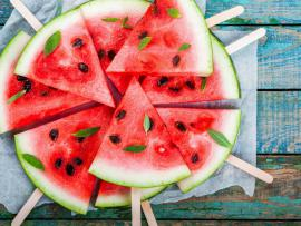 slice of watermelon arranged on a plate and garnished with mint