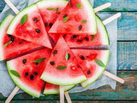 slices of watermelon garnished with bits of mint