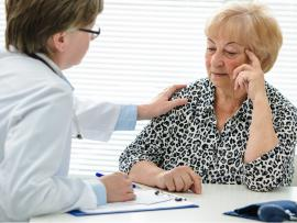female doctor comforting an older female patient