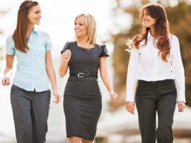 three women in work attire taking a walk break