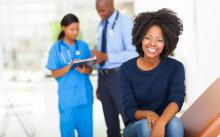 african american woman at appointment with gynecologist