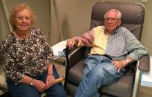 Couple sitting together prior to PET scan imaging for IDEAS research