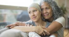 A woman is comforted after a cancer diagnosis.