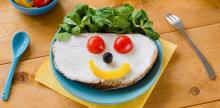 healthy food arranged on wood table in the shape of a smile