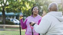 overweight African-American couple exercising outside