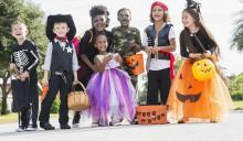 kids dressed up and ready for halloween trick or treating