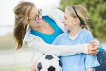 mother and daughter at soccer game