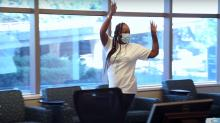Carilion Clinic Orthopaedics patient dances after reunion with her care team.
