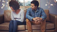 couple sitting on the couch dealing with relationship problems